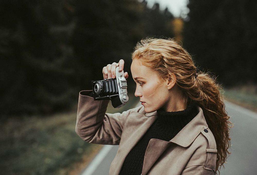 Portraitfotograf in Siegen mit Kamera